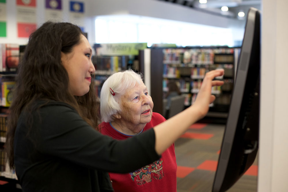 CRPL-librarian-helping-older-lady-touch-screen
